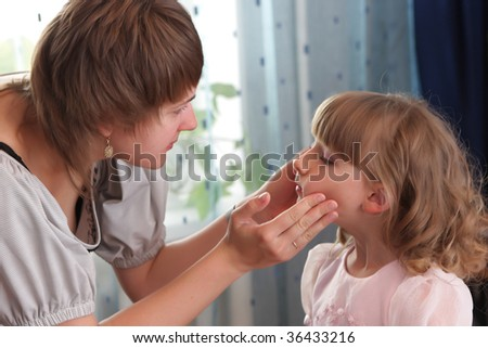 The woman inspections a girl before holiday