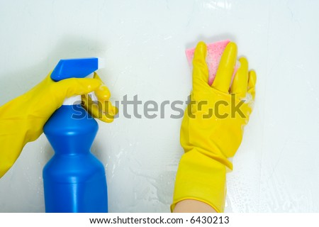 The woman is engaged in cleaning in the house