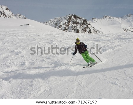 The woman is skiing at a ski resort - stock photo