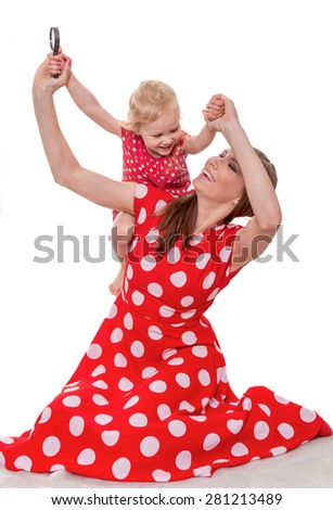 The woman lifts the girl for hands  - stock photo