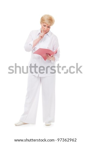 The woman looks at a folder  isolated against white background