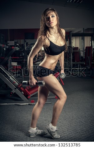 The  woman making workout in gym - stock photo