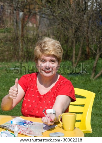 The Woman measures the Pressure and rejoices that it in rate - stock photo