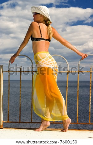 The woman on seacoast - stock photo