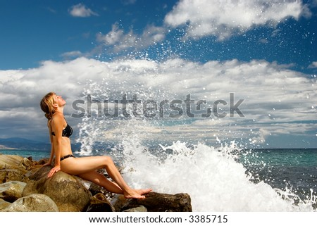 The woman relaxs on a stone - stock photo