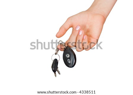 The woman submits a key with a charm from the machine - stock photo