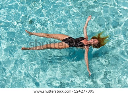 The woman swims in the sea