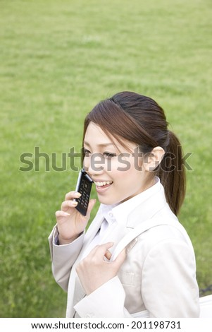 The woman talking on a mobile phone - stock photo
