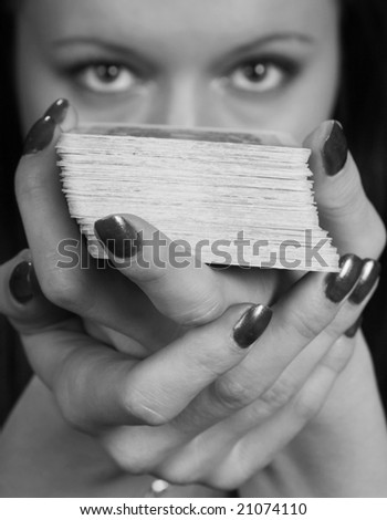 The woman tells fortune. On a black background