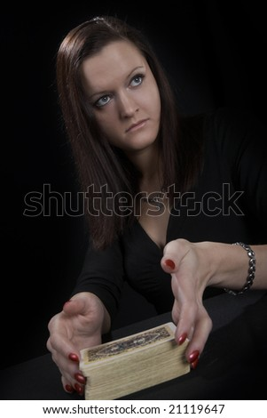 The woman the fortuneteller on a black background
