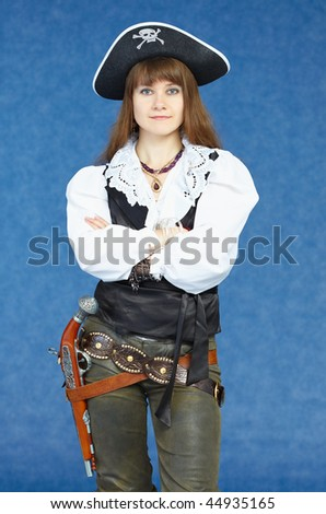 The woman - the sea pirate on a dark blue background with a pistol - stock photo