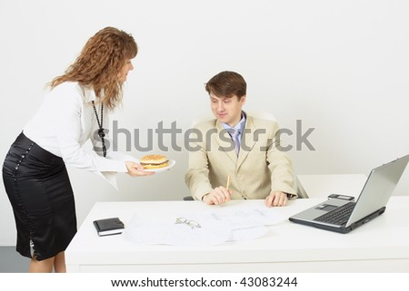 The woman the secretary delivered to the businessman a hamburger to a dinner - stock photo