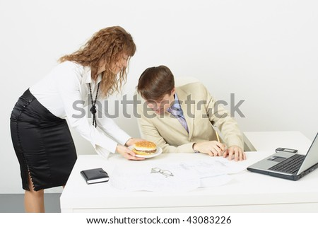 The woman the secretary delivered to the chief a sandwich to a dinner - stock photo