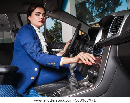 The woman the steering wheel of the car.Test Drive