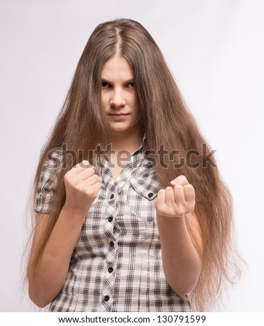 The woman took a fighting stance - stock photo