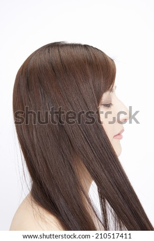 The Woman Touching The Straight Hair