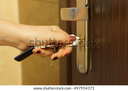 Locked door stock images royalty free images vectors shutterstock the woman turns the key in the lock on the outside door open ccuart Gallery