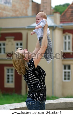 The woman walk with the child in park. - stock photo