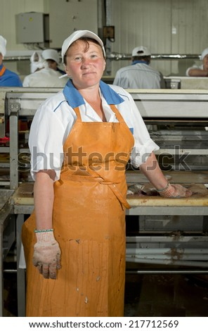 The woman was treated fish at the fish factory. Primorye, the settlement of the Transfiguration,  Russia  - stock photo