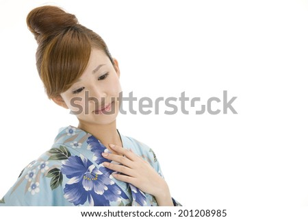 The woman wearing a Yukata putting her hand on a collar