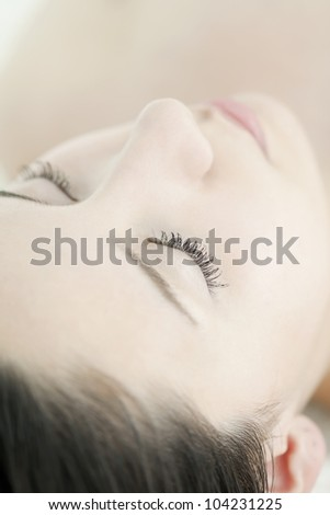 The woman who closes her eyes - stock photo