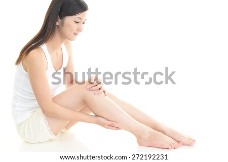 The woman who is doing leg massage - stock photo