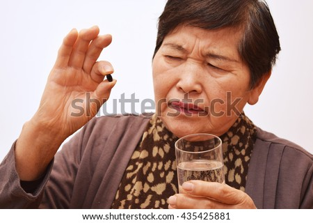 The woman who takes medicine ; Image of bitter medicine - stock photo