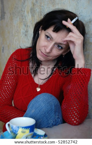 The woman with a cigarette - stock photo