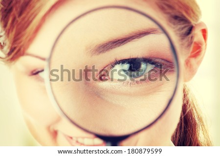 The woman with a magnifier in a hand - stock photo
