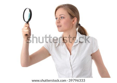 The woman with a magnifier in a hand on the isolated background - stock photo