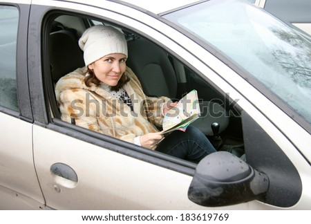 the woman with maps in the car