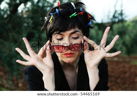 The woman with red glasses in hands - stock photo