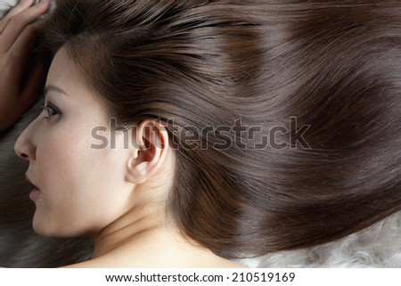 The Woman With Straight Hair - stock photo