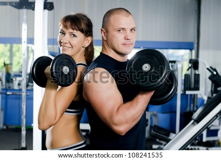 The woman with trainer in sports club - stock photo