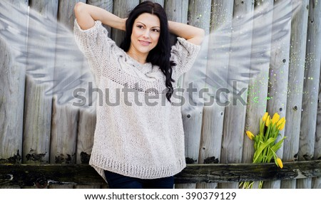 The woman with wings, life full of love and happiness, harmony - stock photo