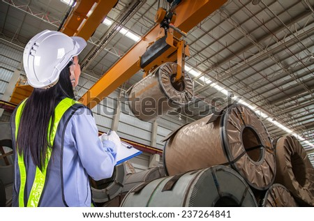 The woman worker report and loading in warehouse  - stock photo