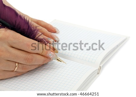 The woman writes a feather to a diary