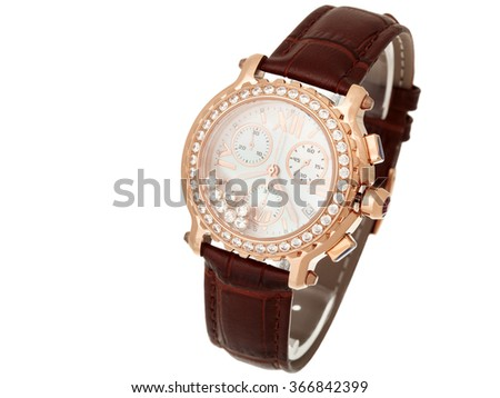 The women gold watch decorated with diamonds with a brown leather thong, on a white background.