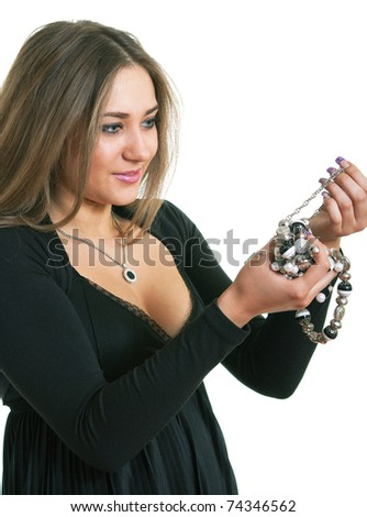 The women in a black dress holds in hands a bead. Isolation on a white background