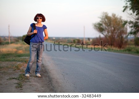 The Women travelling on road - stock photo