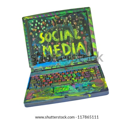 The wonderful world of Social media, grungy painted laptop - stock photo