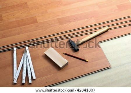 the wood flooring and tools - stock photo