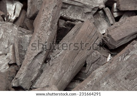 The wood is burned to charcoal black - stock photo