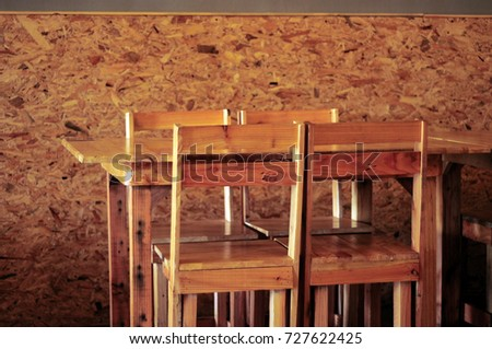The wood table and chairs.