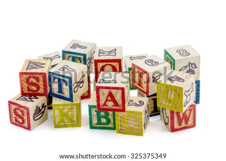 The wooden alphabet blocks on a white background - stock photo