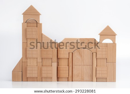 The wooden blocks constitute become a castle. - stock photo
