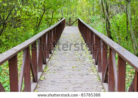 the wooden bridge in the park - stock photo