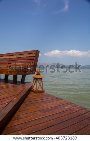 The wooden bridge landing to pavilion in the sea and mangrove rain forestpavilion in the sea