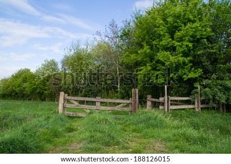 The wooden fence gate in the countryside Doetinchem, Holland/ Netherlands. - stock photo