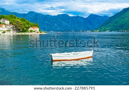 The wooden fishing boat in harbour of Perast, Montenegro. - stock photo